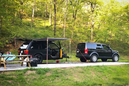 RV, Tent, Trailer camping by the river