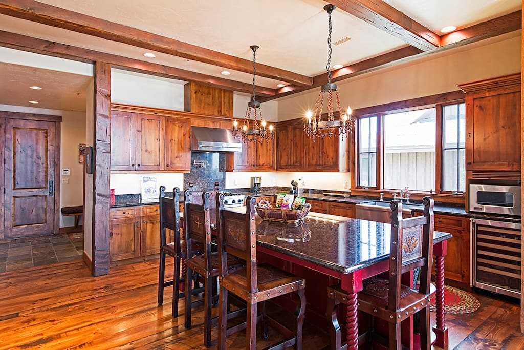 Big, open space with a center prep island that doubles as a 2nd dining area.