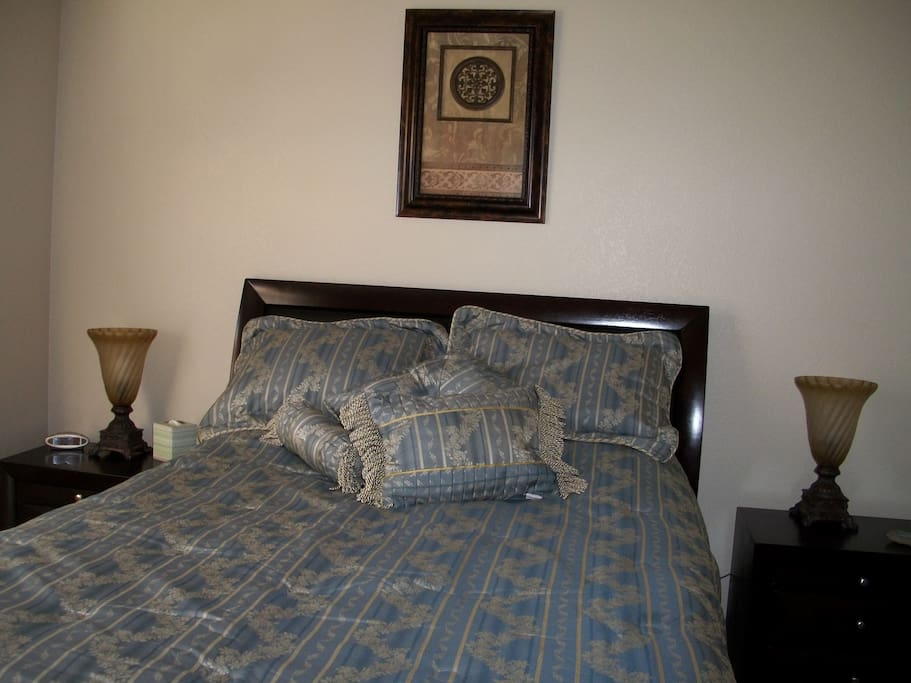 Bedroom with queen size bed and with walk-in closet