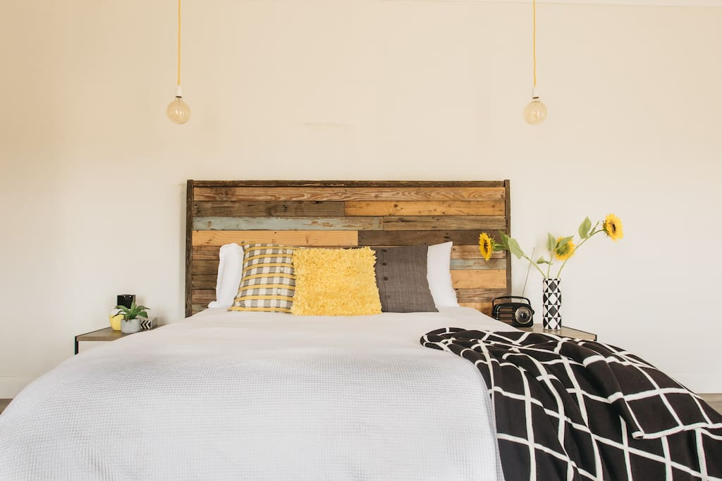 Handmade bed frame from historic timber boards from the main house