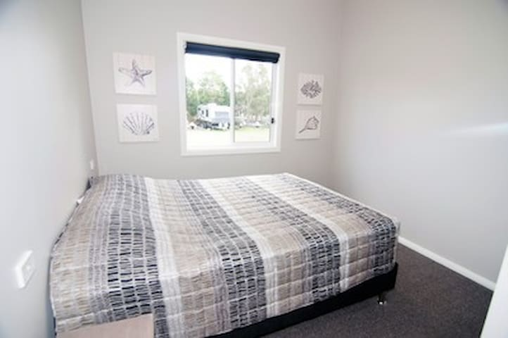 Bedroom one offers a queen size bed