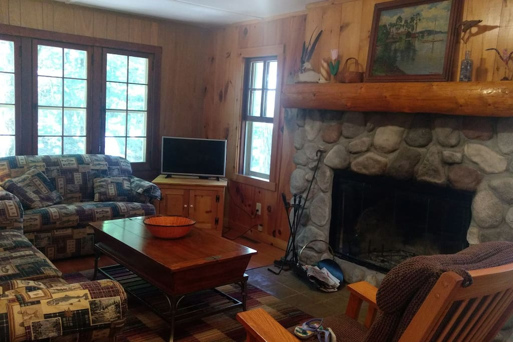 Living room includes wood burning fireplace (free wood)