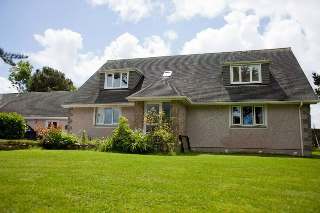A detached 4 bedroom home with private heated swimming pool, hot tub and parking for up to 4 cars.