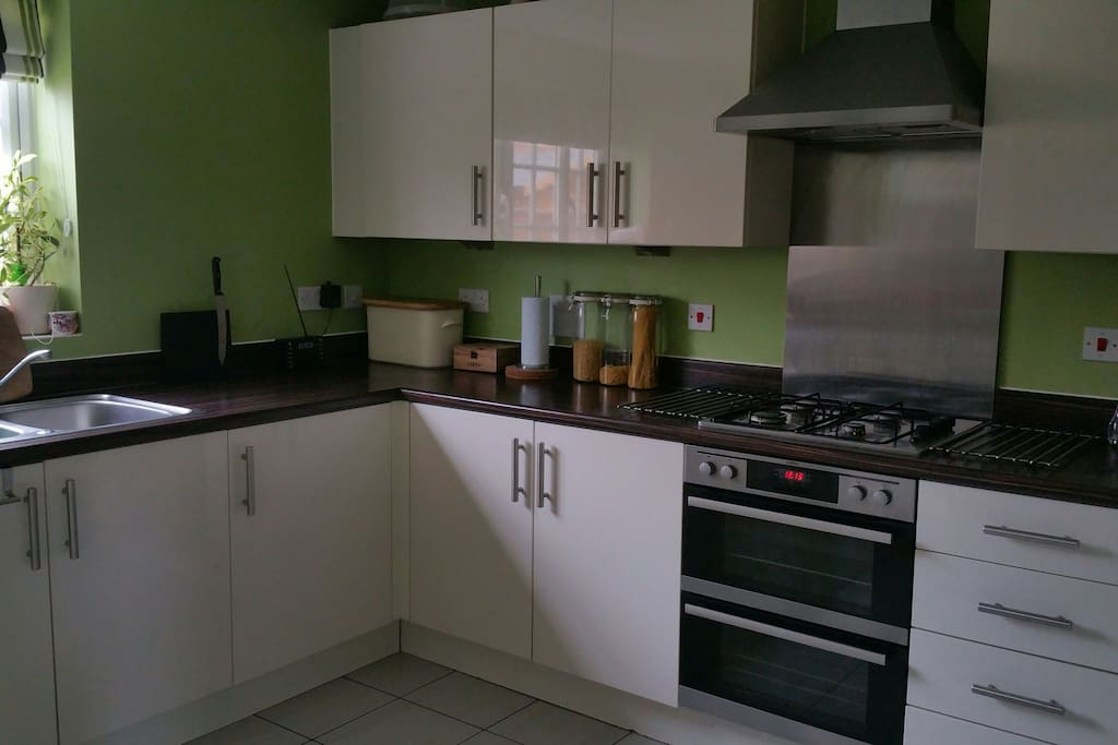 Fully integrated kitchen with dishwasher, fridge freezer, sink, electric oven and gas hob. Separate utility area with washing machine and second sink.
