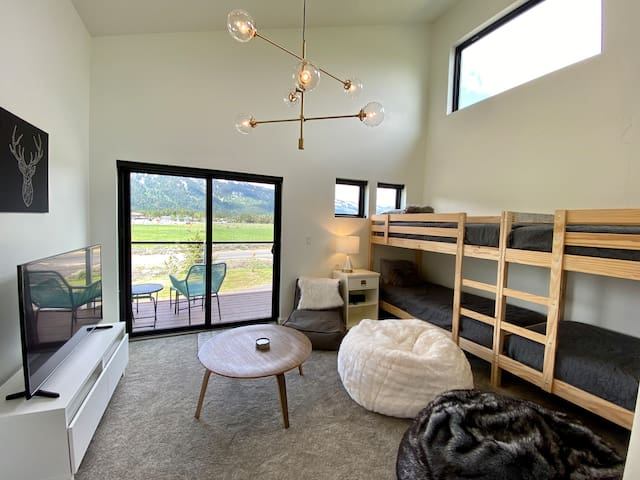 Upstairs bunkroom with balcony access