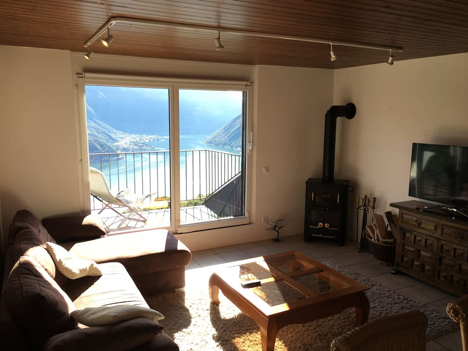Another shot of the living room and in the background is lake Lugano.
