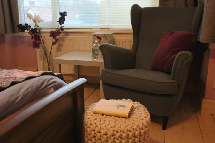 Master bedroom armchair - very comfortable for reading!
