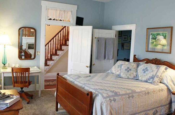 The 1870s room is furnished with a vintage oak bedroom set and has a private bath, accessible from inside the room.