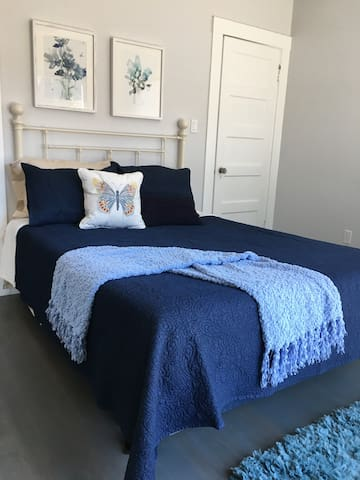 Master bedroom - queen sized bed with large closet.