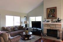 Living room w/ fireplace & TV