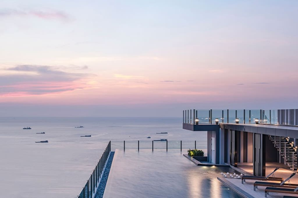 Rooftop swimming pool sunset view