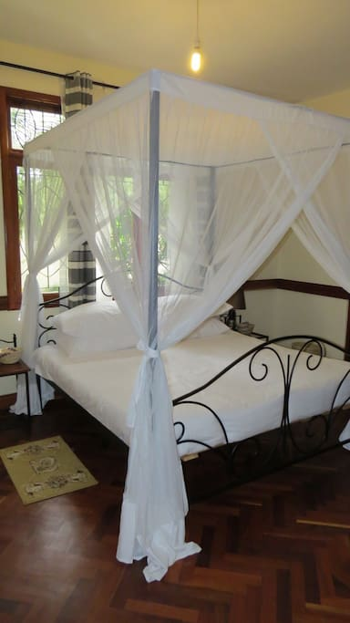 Four poster beds with mosquito nets