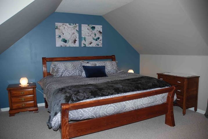 """King size bed with new 14"""" mattress."""