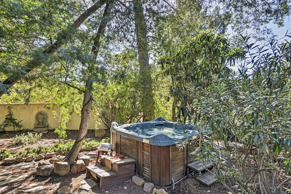 Look forward to soaking in the hot tub surrounded by lush vegetation.