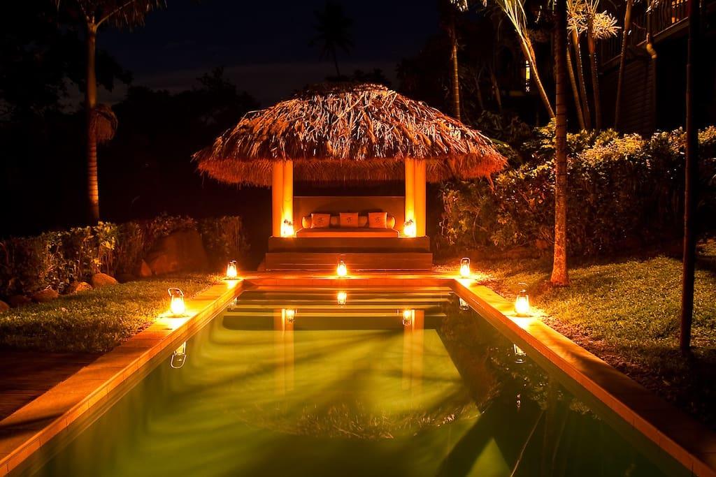 Beach villa pool at night