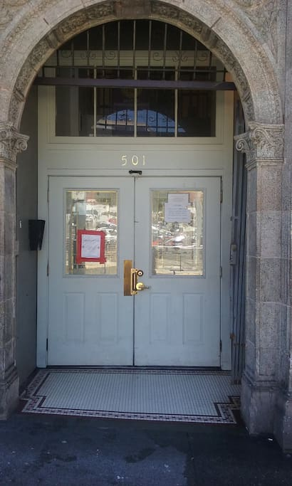 "Front door of the Temple.  Press 202 and call on the ""Call Box""."