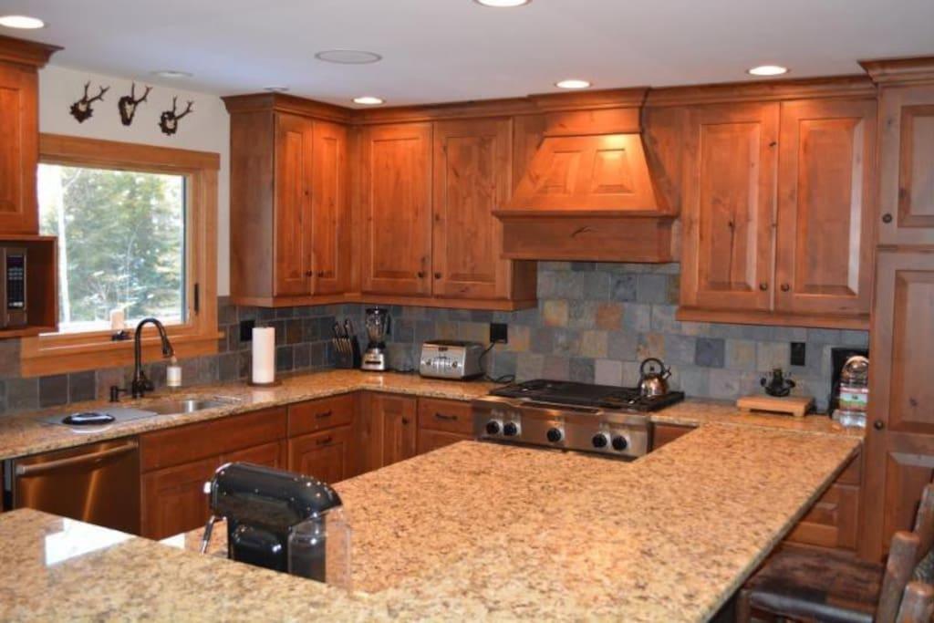Kitchen area, 26 inch dual fuel range, Nespresso machine, Keurig, coffee machine, much more.
