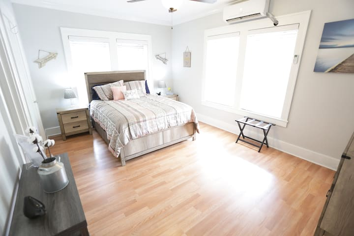 This room is complete with a ductless AC/Heating unit and a modern ceiling fan to accommodate you in any weather. Powered by a remote.