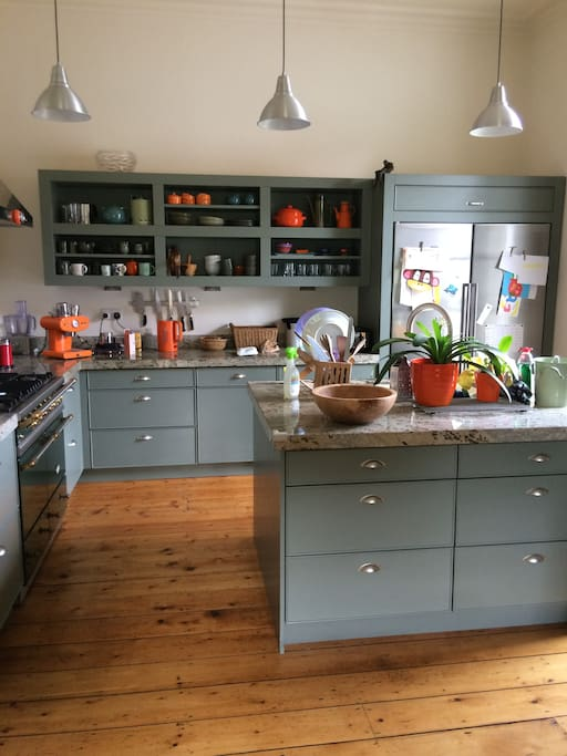 The kitchen is bright and spacious and well equipped