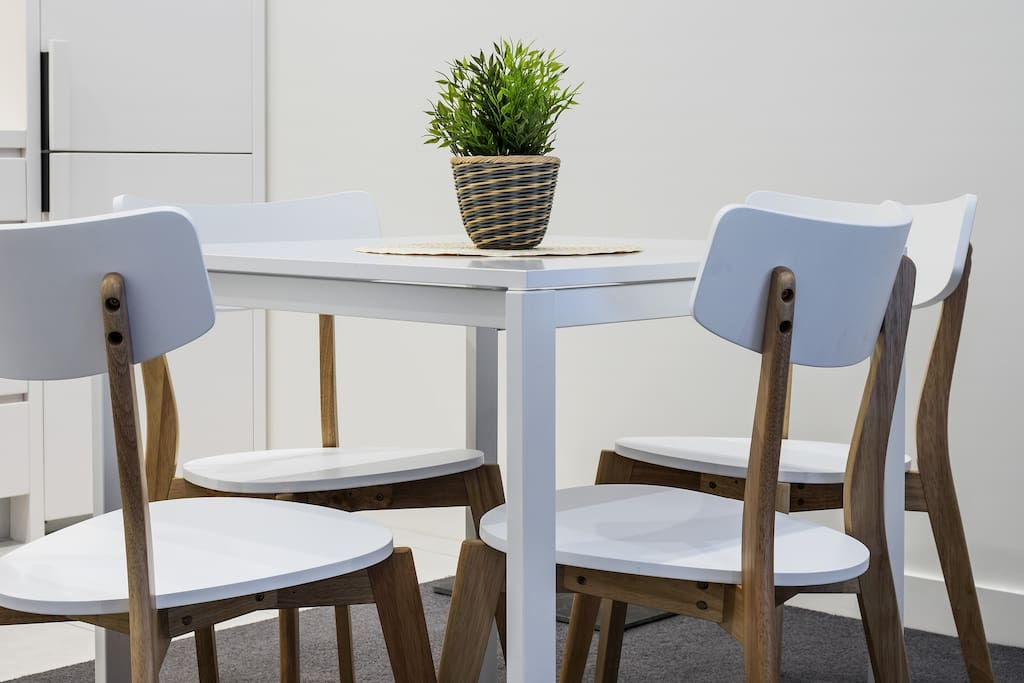 A cosy 4-seater dining table to dine on.