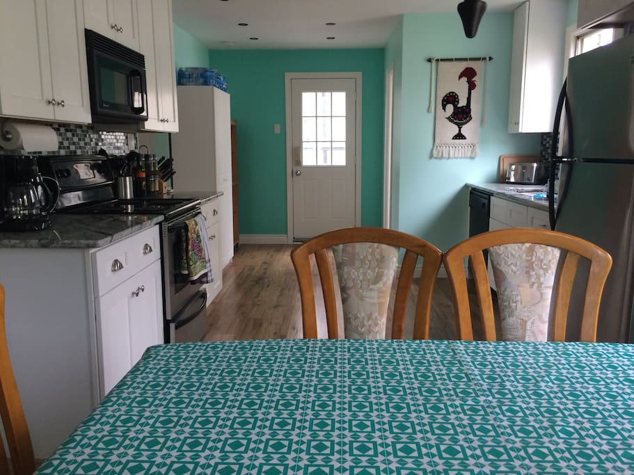 Wide kitchen allows you to socialize and cook with ease. Side entrance door and bathroom tucked away for easy access.   Guests will have a selection of cereals and other breakfast food made available to them. A shelf in the pantry is also provided to store your non perishable food items