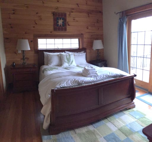Queen with private bath on first floor. Door to hot tub with long range views.
