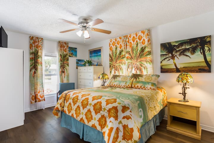 Master bedroom with attached bathroom. Bright, airy, tropical with lots of natural light.