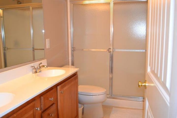 3rd floor- bathroom with dual sinks and oversized stall shower