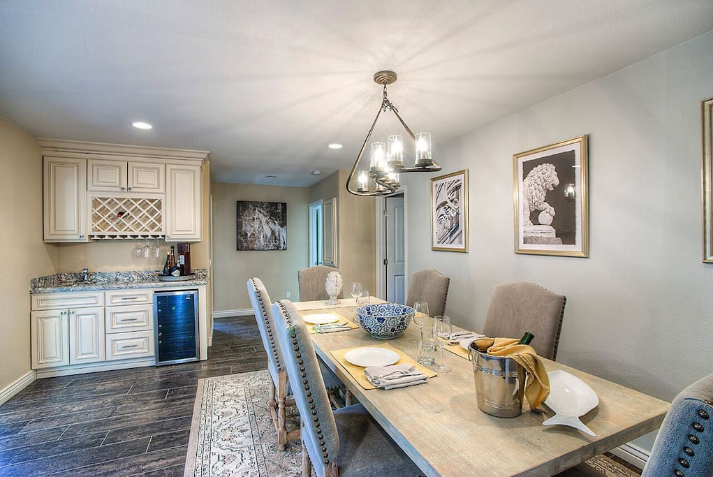 Formal dining with Wet bar, wine rack, wine cooler and service sink