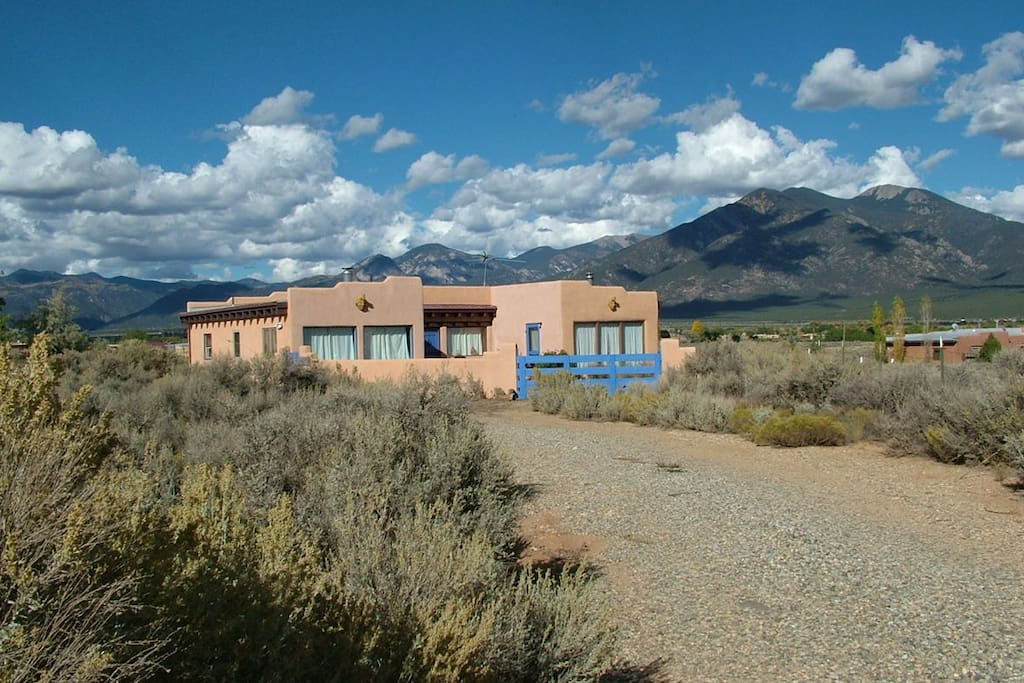 Nestled in the Sangre de Cristo Mountain range with panoramic views, this 2BR adobe-style home provides ample space to sprawl out and relax.