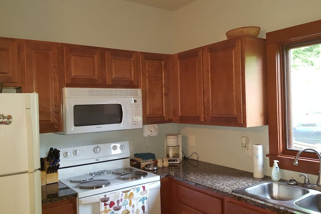Fully furnished kitchen, including oven, fridge, dishwasher, disposal, microwave, and coffee pot. Everything you need to cook a meal.  If you need a special utensil, I probably have that to lend you from the main house!