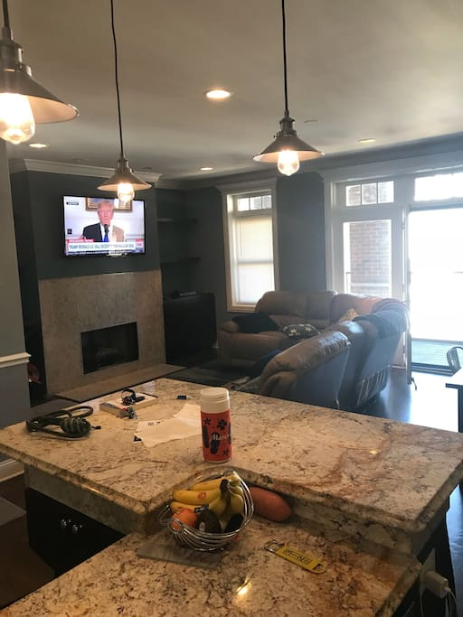 Recently renovated main living space with large sectional, bar top counter, and plenty of seating