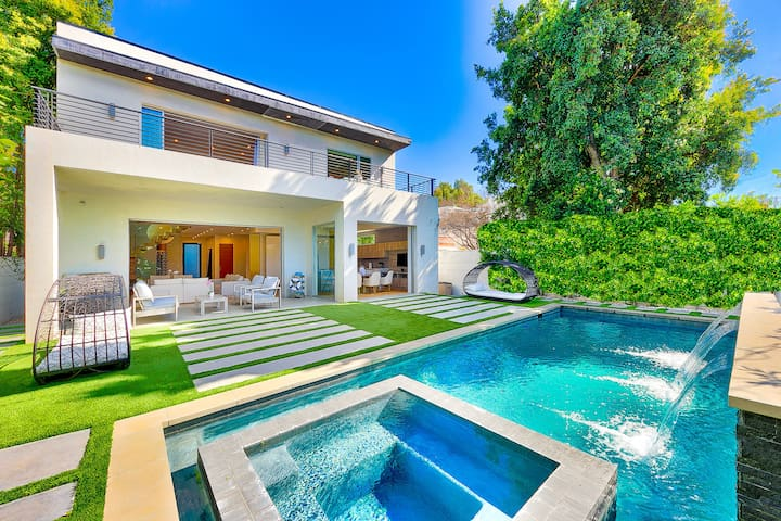 Backyard including Jacuzzi, Waterfall, Pool, Synthetic Grass.