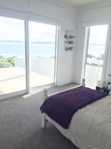 View & deck from bedroom with King single bed.