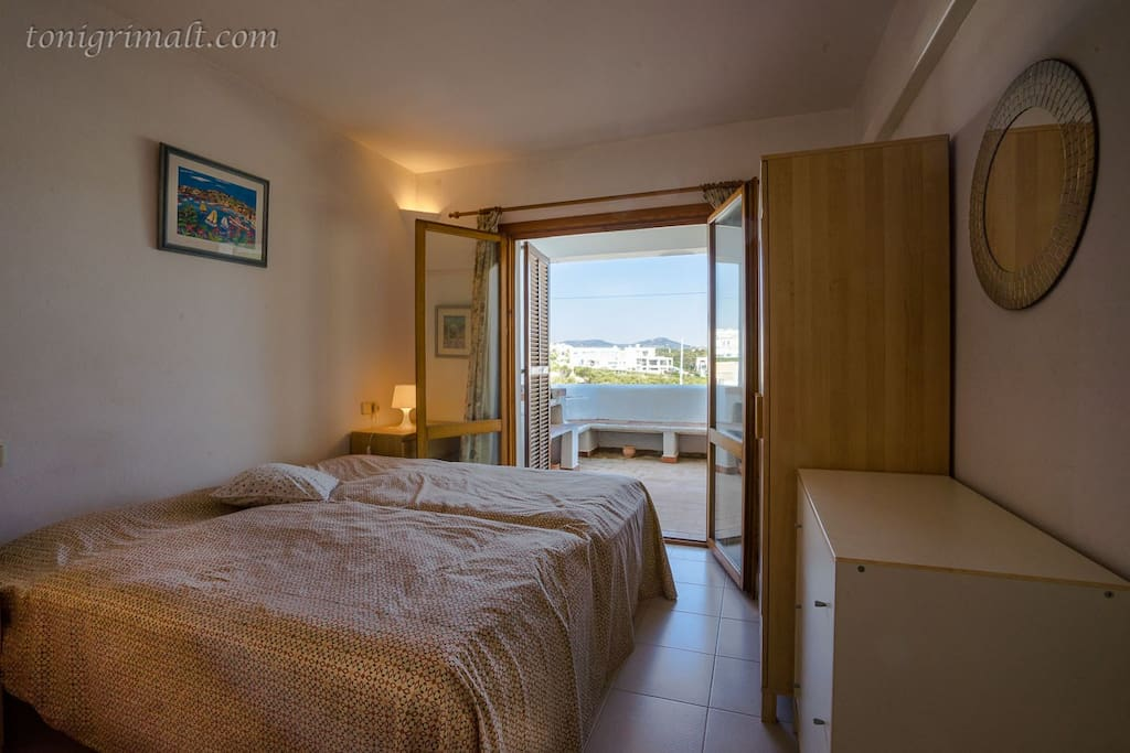Main Bedroom ( 2 - single beds) with door to Terrace  and sea/harbour views.
