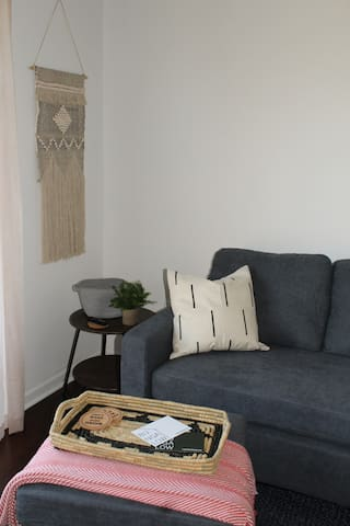 Living Area couch that can be changed into a sectional by switching out seat cushions.