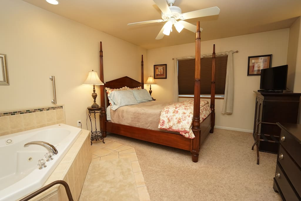 This lovely suite bedroom is equipped with a jacuzzi tub and dressing room.  Cable tv and many lighting options.