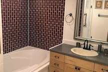 Bathroom  - Garden tub with separate walk-in shower. Marble tile flooring.