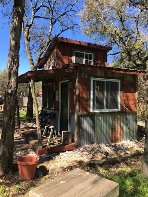 Hideout is a small cabin with lots of windows for great views of the property.