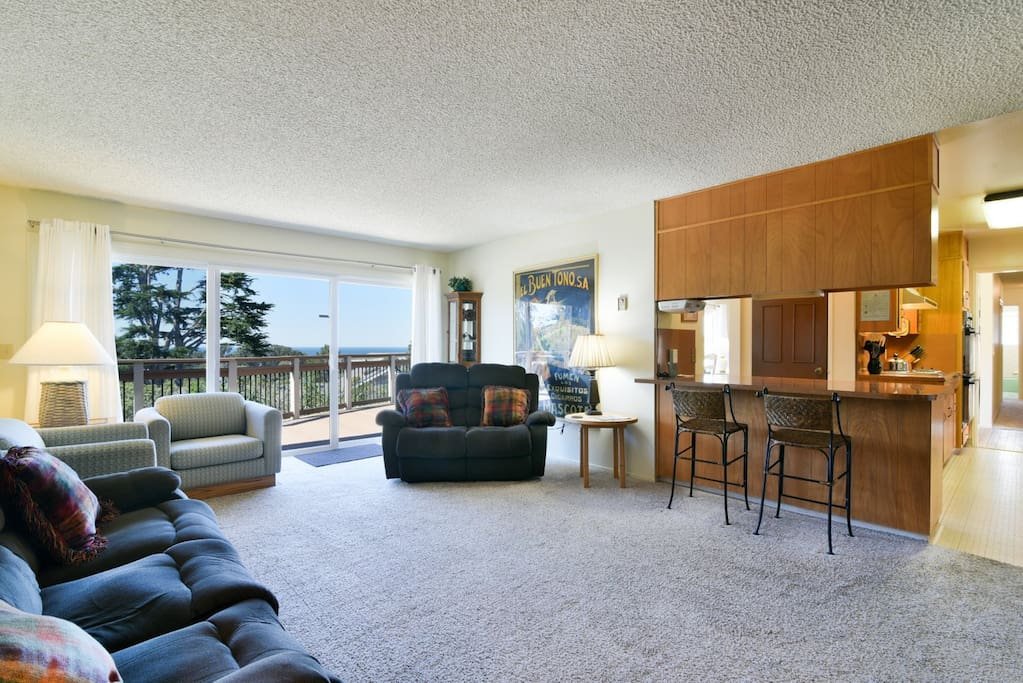 The large den is open to the kitchen and perfect for friends and family