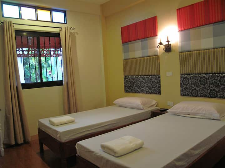 Twin beds room in charming old-Filipino style home