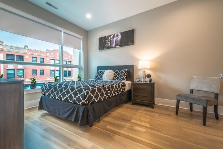 Guest bedroom offers one queen bed and closet!