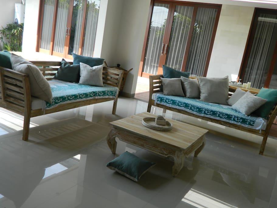 Living area styled with coastal hues.