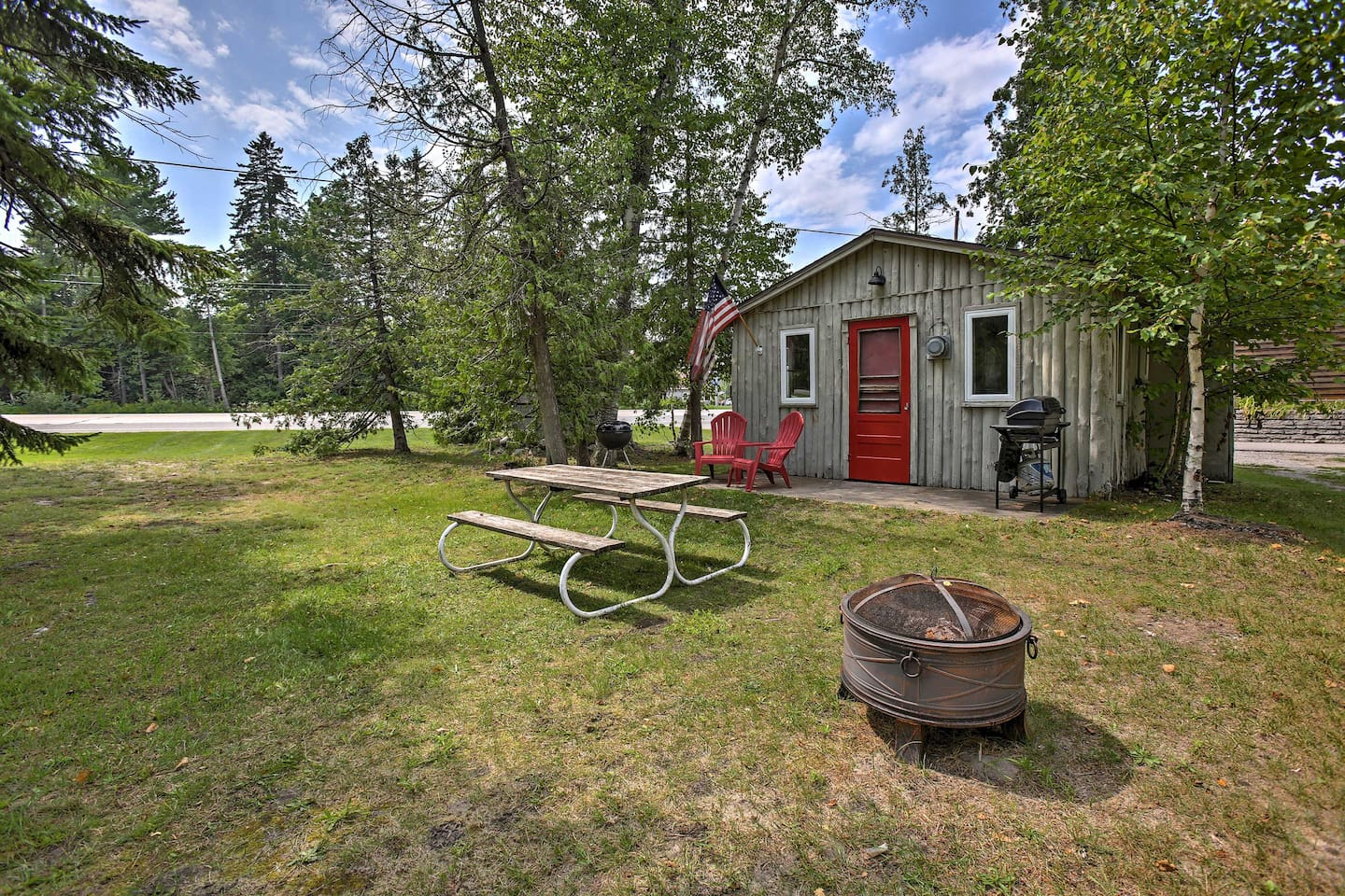 Visit Suttons Bay & stay in this charming 1-bed, 1-bath vacation rental cottage.