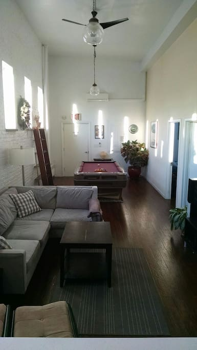 Living room - view from kitchen to entrance