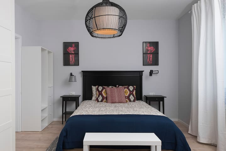 Large bedroom with double bed and a multitude of closet space.