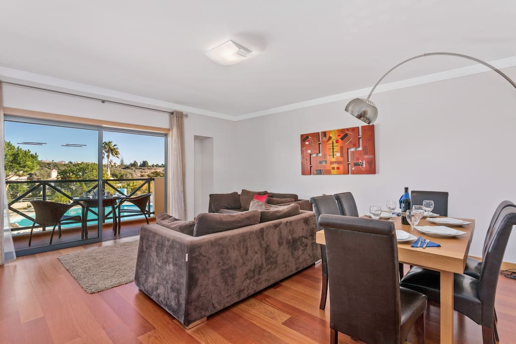 Open plan living and dining area leading out to balcony