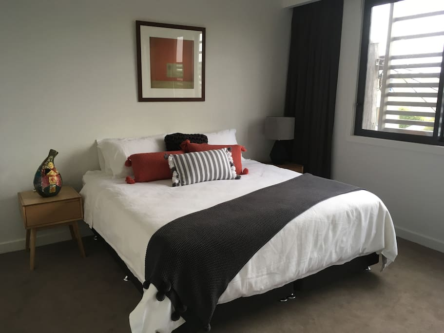 main bedroom with King bed, aircon and ensuite