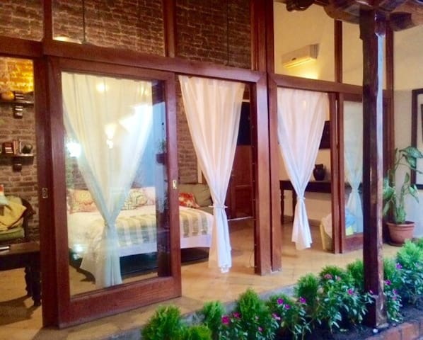 Sliding doors of downstairs bedroom can be opened for breeze or closed for AC in the Sala. With glass doors and front wooden door open, the house gets a great breeze throughout