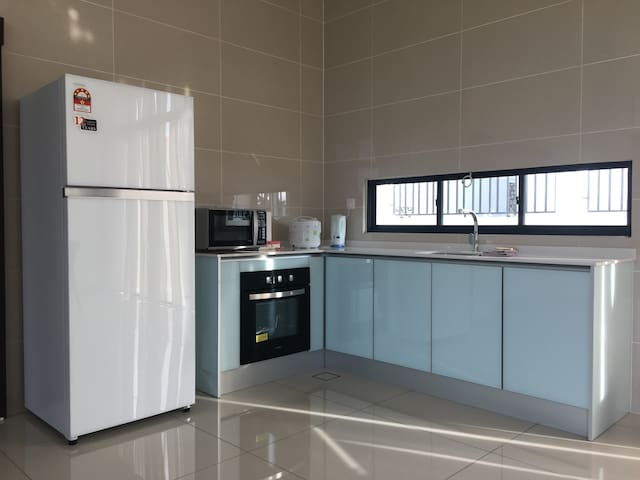 Dry kitchen - with fridge, microwave oven, rice cooker, hot water boiler, built-in electric oven